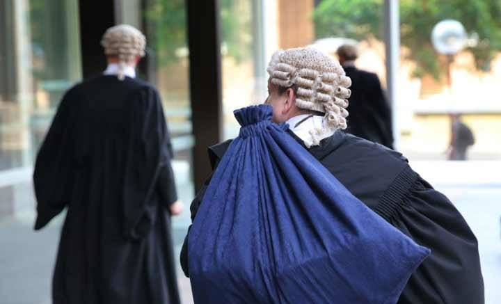 barristers arriving at NSW supreme court to battle over a liquidation